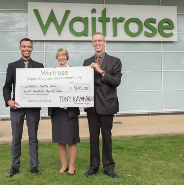 Themba & Gerbo accepting a grant from Waitrose!